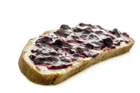 jam sandwich: Bread slice with jam and butter isolated on a white background  Shallow dof  Stock Photo