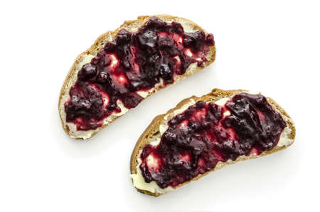 jam sandwich: Top view of two pieces of bread with jam and butter isolated on a white background
