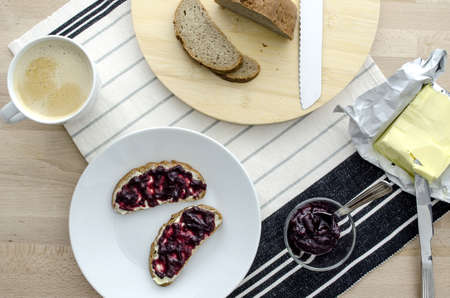 jam sandwich: Top view of breakfast with coffee, bread, jam and butter  Stock Photo