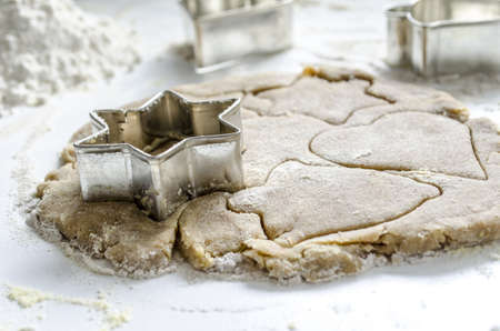 cookie cutter: Cookie dough with cookie cutter and flour ready for baking