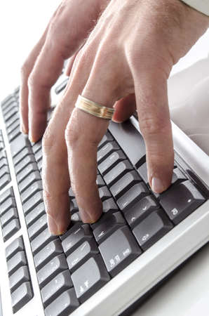 Closeup of  hands typing on computer keyboard  photo