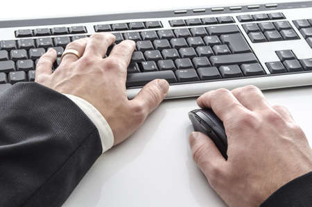 Closeup of male hands typing on keyboard on a white table Stock Photo - 17010956
