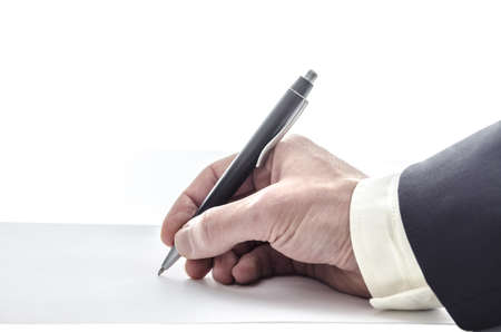 Hand of a man in suit writing on a blank paper, with copyspace  photo
