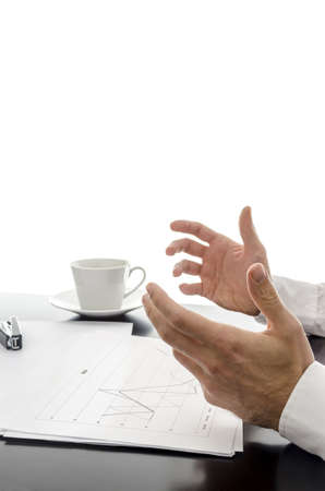 Businessman explaining strategy with financial documents in front of him  photo