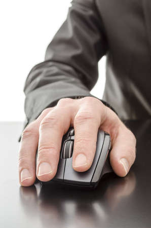 Male hand using a computer mouse on a black table  photo