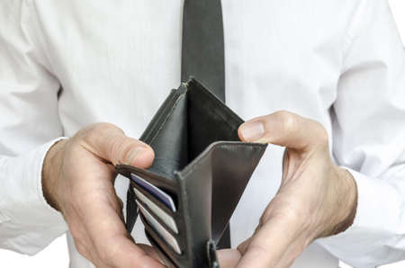 bankrupt: Man in white shirt and black tie holding an empty wallet  Stock Photo