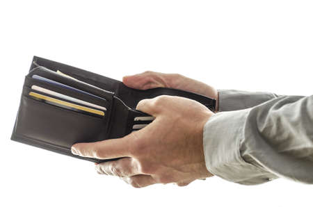 pay for: A man opening his  wallet to pay for something
