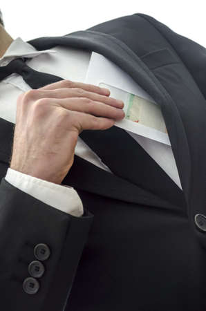 Man putting envelope in his pocket  Metaphor for corruption  photo