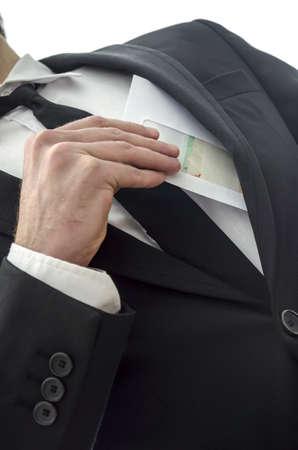 Man putting envelope in his pocket  Metaphor for corruption
