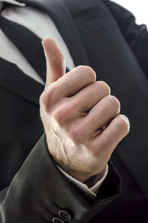 Businessman s hand with thumb up sign Stock Photo - 17296736