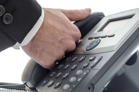 Closeup of a male receptionist making a phone call Stock Photo - 17296618