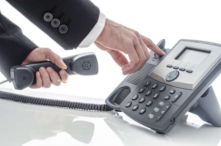 telephone receiver: Closeup of a business man hanging up the phone  Stock Photo