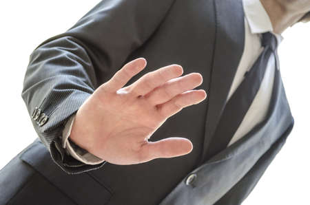denial: Cropped view of a man refusing an offer with stop gesture