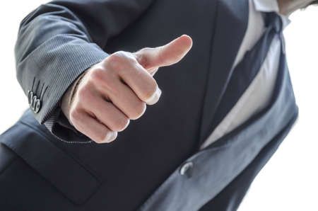 Cropped view of a business man showing thumbs up gesture  Stock Photo - 17296615