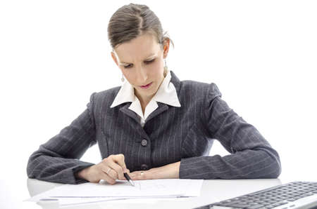 Business woman analyzing documents at office desk  Isolated over white background Stock Photo - 17410779