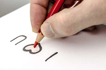 Male hand writing a love message on a white paper  photo