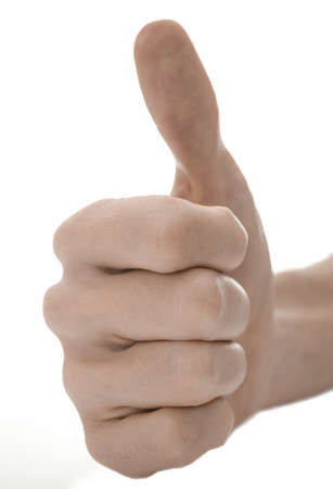 Closeup of a hand with thumb up sign  Isolated on a white background  Stock Photo - 17508223