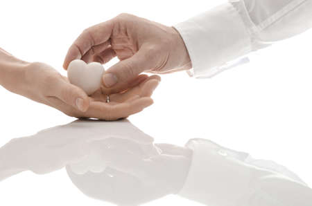 heart of stone: A man giving heart made of white marble as a gift to his girlfriend  A beautiful love concept