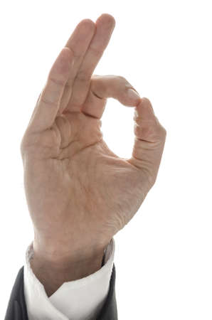 Hand of a businessman showing an Ok sign  Isolated over white background  Stock Photo - 17508291