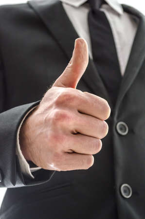 Business man showing a thumbs up sign  Cropped bottom view  Stock Photo - 17623439