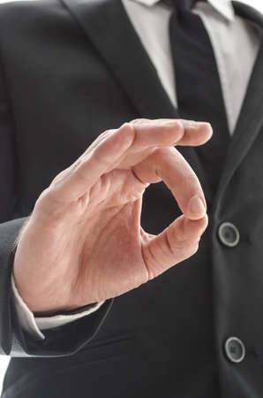 Business man showing an Ok gesture  Cropped bottom view  Stock Photo - 17623443