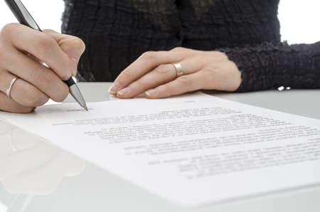 Cropped view of a business woman signing a contract above signature line Stock Photo - 17623458