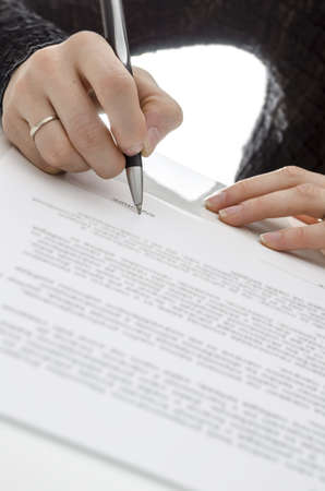 Cropped view of a business woman signing a contract Stock Photo - 17623455