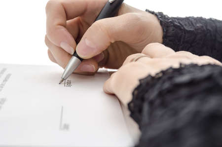 Closeup of a businesswoman signing a contract above signature line  photo