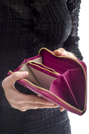Woman in a black dress holding an empty wallet  Stock Photo