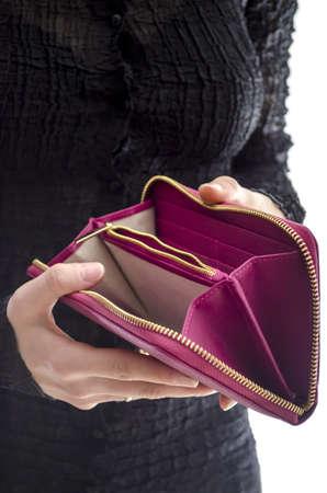 broke: Woman in a black dress holding an empty wallet  Stock Photo