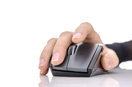 Font view of a female hand using a computer mouse  photo