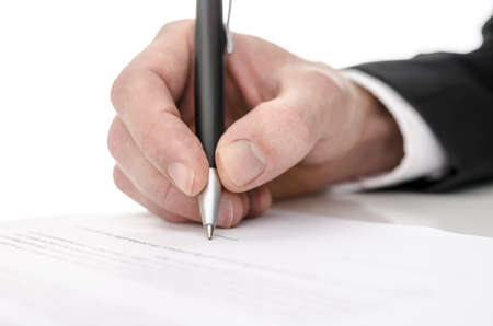 testimony: Business man signing a contract  Shallow depth of field
