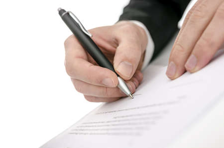 subscribing: Cropped view of a business man signing a contract  Shallow focus on signature
