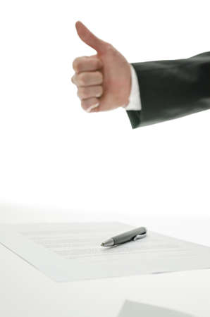 acknowledgment: Business man showing thumbs up sign over a signed contract   Focus on a pen  Stock Photo