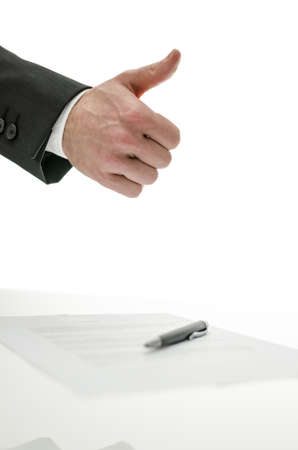 acknowledgment: Business man showing thumbs up sign over a signed contract   Isolated over white background