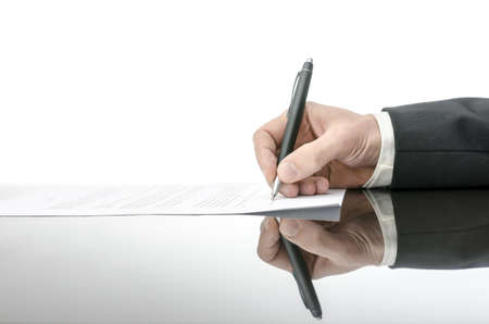 lawsuit: Signing a contract on a black table  With copy space and reflection  Stock Photo