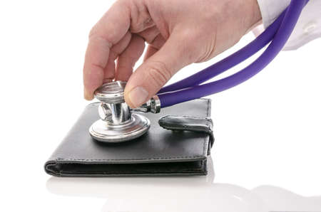 Male hand checking a wallet with stethoscope  Isolated over white background  photo