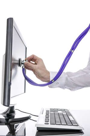 Testing a computer desktop with stethoscope  Isolated over white background  photo