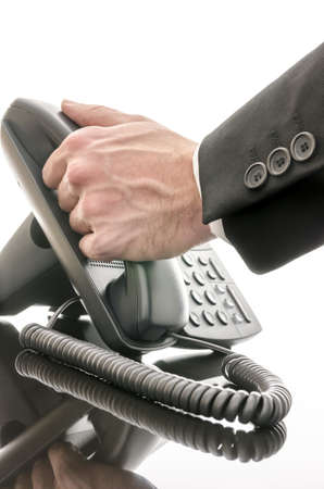 Cropped view of a male hand answering a phone on a black office table  photo