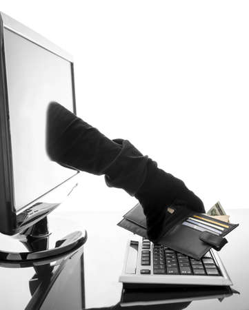 identity thieves: Thief with glove stealing wallet through a computer screen  Concept of internet crime  Stock Photo