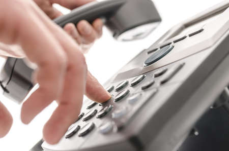 Dialing a phone number closeup with shallow depth of field Stock Photo - 18266879