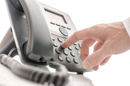 phone number: Hand of an operator dialing a phone number  Isolated over white background