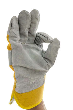 Gloved hand of a construction worker showing an Ok sign  Isolated over white background Stock Photo - 18285163