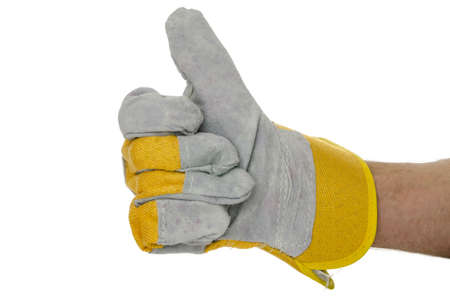 Gloved hand of construction worker showing thumbs up sign  Isolated over white background  Stock Photo - 18285160