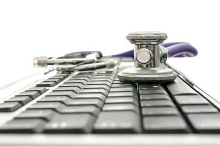 Detail of black computer keyboard with stethoscope  With copyspace  photo