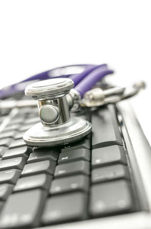 Computer keyboard and a medical stethoscope  With copy space  photo