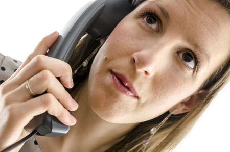Portrait of a businesswoman using a telephone handset. Cropped front view. photo