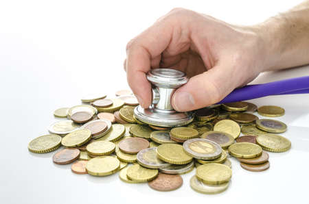 Male hand with stethoscope over Euro money  Concept of financial crisis Stock Photo - 18539123