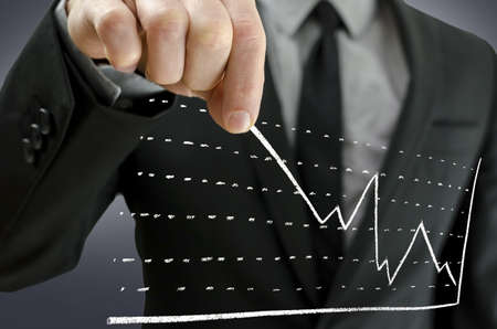 Businessman pulling business graph upwards on a virtual screen  Concept of financial crisis recovery Stock Photo - 18539152