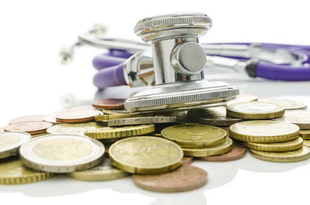 Stethoscope over Euro coins  Concept of saving bad economy   photo